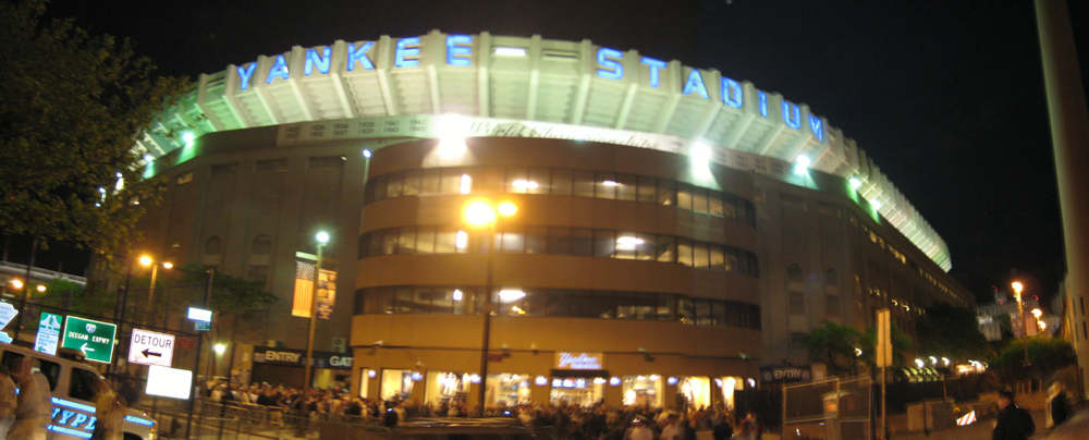 View from street level behind home plate at night
